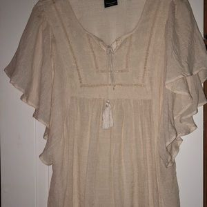 Woman's cream colored babydoll top